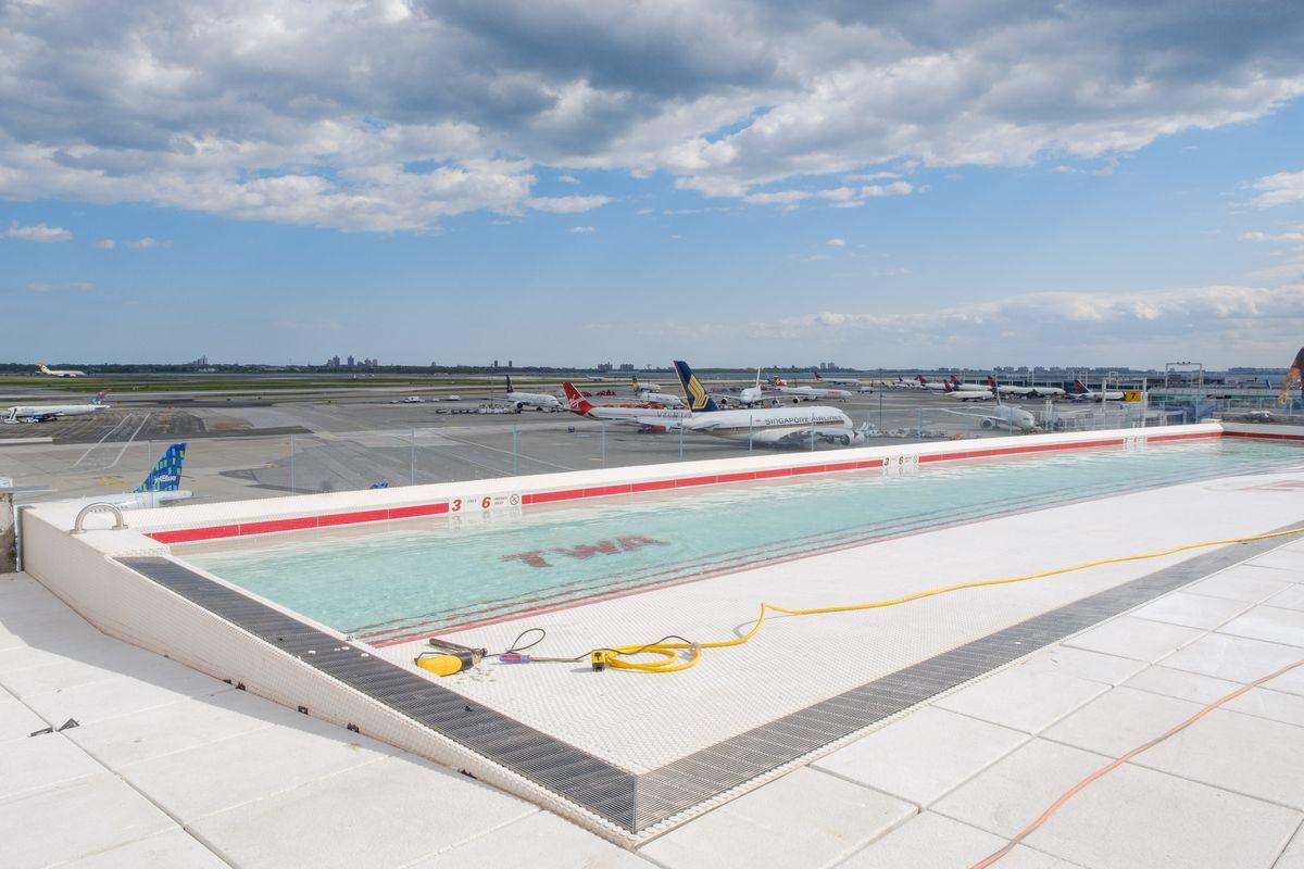 An infinity pool overlooking a JFK runway