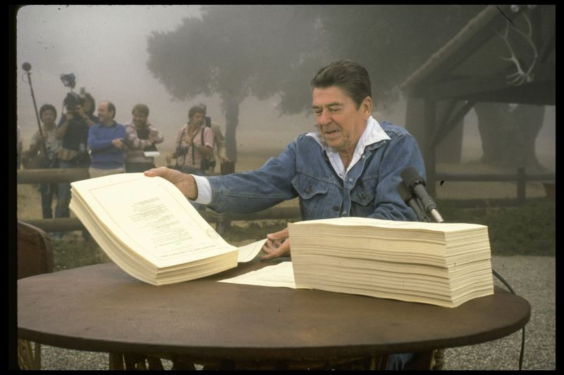 President Ronald Reagan signs the Economic Recovery Tax Act of 1981,while on vacation at his ranch named Rancho del Cielo.