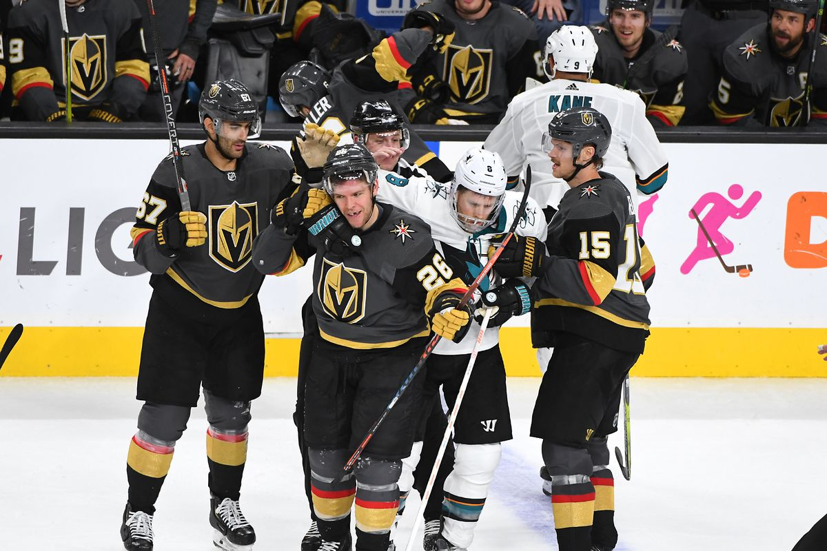 Golden Knights defenseman Colin Miller falls to the ice after taking a punch from San Jose Sharks left wing Evander Kane as center Joe Pavelski scuffles with center Paul Stastny  and defenseman Jon Merrill during Game 4 of the first round of the 2019 Stan