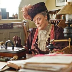The Dowager looking severe in burgundy.
