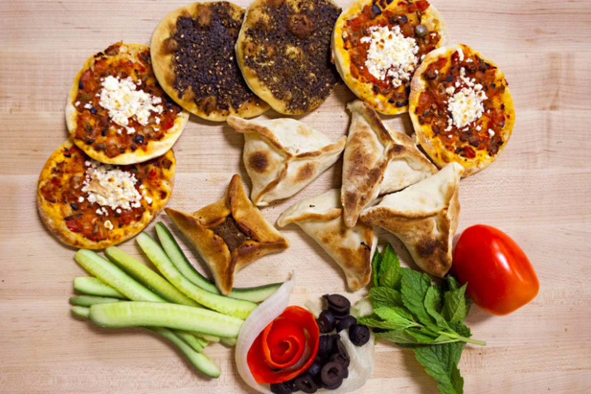 An assortment of Lebanese flatbreads and pastries.