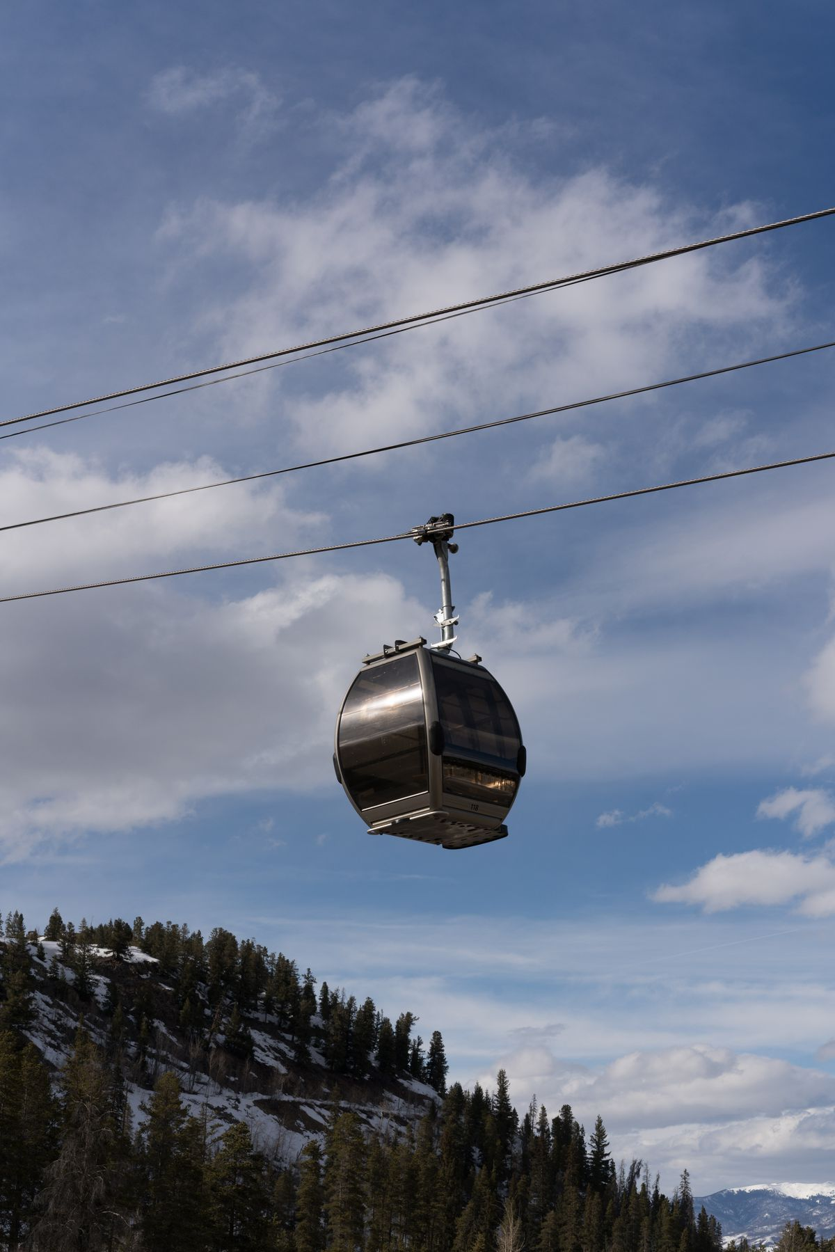 Gondola in Breckenridge with the mountains below.