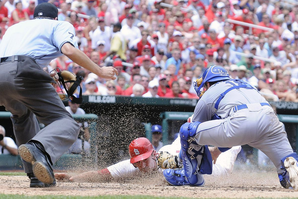 July 26, 2012; St. Louis, MO. USA; St. Louis Cardinals first baseman Matt Carpenter (13) is tagged out by Los Angeles Dodgers catcher Matt Treanor (18) in the fourth inning at Busch Stadium. Mandatory Credit: Jeff Curry-US PRESSWIRE