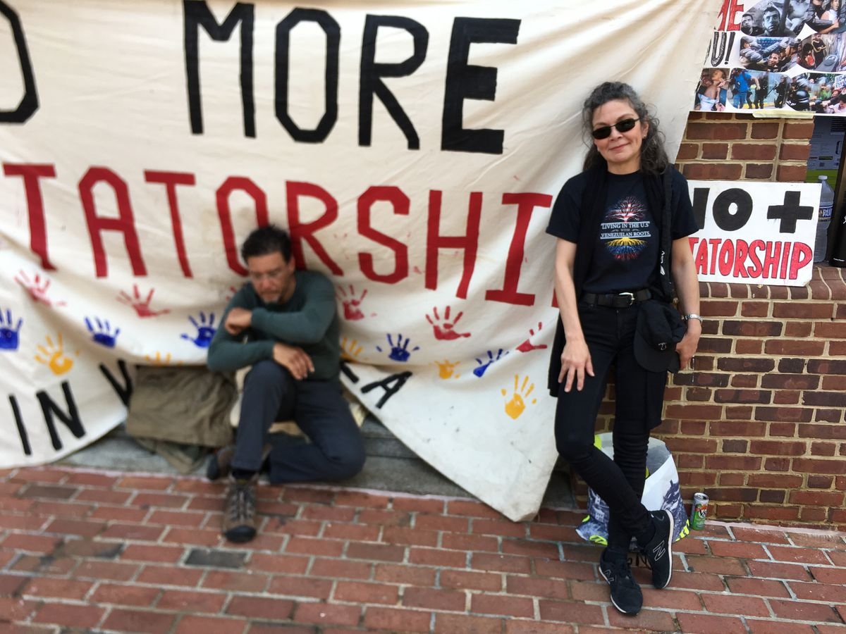 Matthew Burwick Orta, left, alongside Luisa Fernandez Alivizu outside the Venezuela embassy on May 2, 2019.