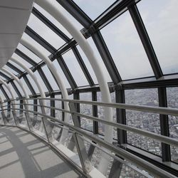 Journalists walk on the 450-meter (1,476 feet)-high observation deck of the Tokyo Sky Tree during a press preview in Tokyo Tuesday, April 17, 2012. The world's tallest freestanding broadcast structure that stands 634-meter (2,080 feet) will open to the public in May.