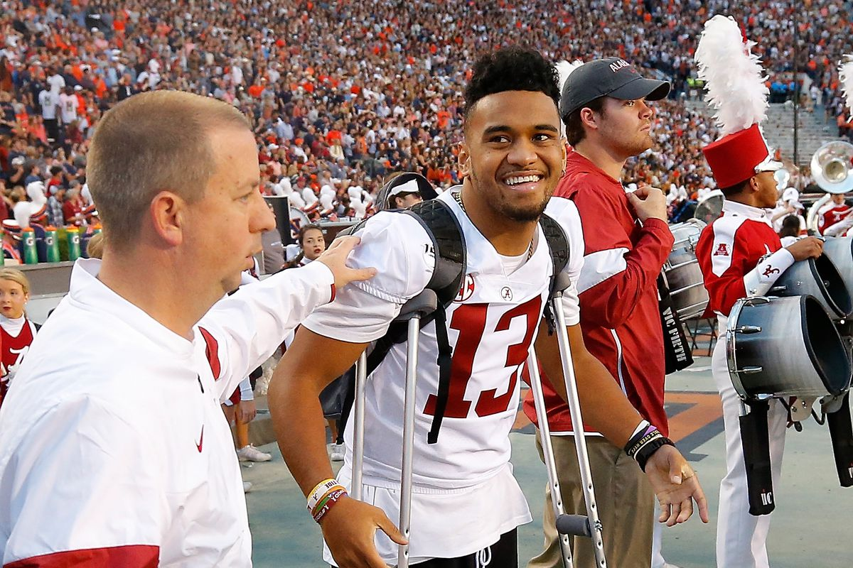 Tua Tagovailoa of the Alabama Crimson Tide stands on the sidelines during the final seconds of the first half against the Auburn Tigers at Jordan Hare Stadium on November 30, 2019 in Auburn, Alabama.