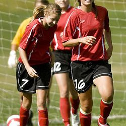 Bountiful's Paige Hunt, left, and Hannah Marble trot back after a goal as Park City hosts Bountiful in preseason high school soccer on Tuesday. Bountiful won 6-0. Marble left the game with a hat trick.