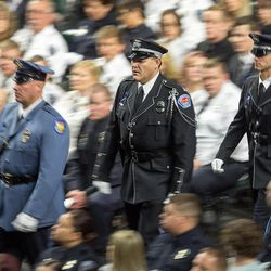Officers walk to their seats at funeral services for Unified Police officer Doug Barney at the Maverik Center in West Valley City on Monday, Jan. 25, 2016.