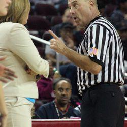 Referee Bob Scofield warns UCLA coach Cori Close.