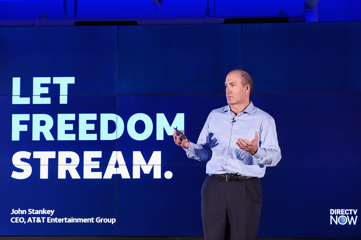 "WarnerMedia's John Stankey onstage in front of a backdrop that reads, ""Let freedom stream"""