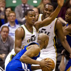 Jazz guard Alec Burks (10) plays defense on Warriors guard Jarrett Jack (2) during the first half of the NBA basketball game between the Utah Jazz and the Golden State Warriors at Energy Solutions Arena, Wednesday, Dec. 26, 2012.