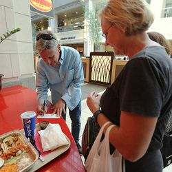 Libertarian presidential candidate Gov. Gary Johnson signs an autograph for a woman who recognized him at Taste of Red Iguana in the food court at City Creek Center as he and running mate Gov. Bill Weld pay a visit to Salt Lake City for a speech at the University of Utah on Saturday, Aug. 6, 2016.