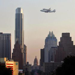 Space shuttle Endeavour sits atop the shuttle aircraft carrier, passes above Austin, Texas, Thursday, Sept. 20, 2012.   Endeavour is making a final trek across the country to the California Science Center in Los Angeles, where it will be permanently displayed.