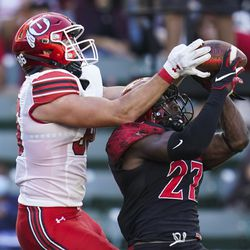 Utah tight end Dalton Kincaid (86) and San Diego State safety Cedarious Barfield (27) try to catch a pass intended for Kincaid in the end zone during the first half of an NCAA college football game Saturday, Sept. 18, 2021, in Carson, Calif. The pass was incomplete.