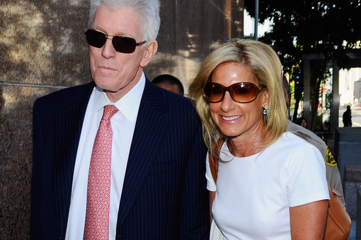Ted Danson seems bored to death here with Jamie McCourt.