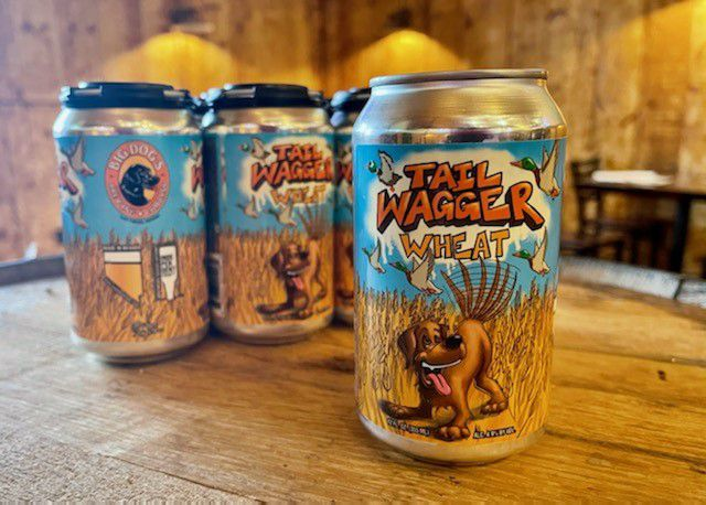 Three cans of beer with a dog on them