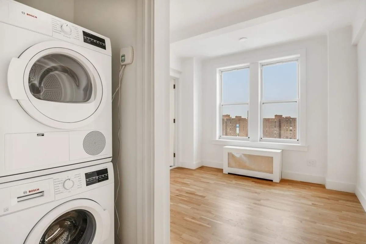A living area and a washer/dryer on the left.
