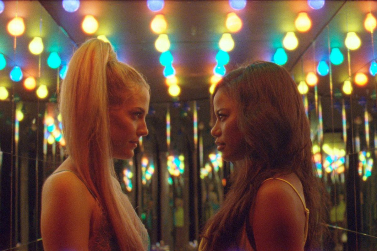 """Riley Keough (left) and Taylour Paige are shown in a scene from """"Zola."""""""