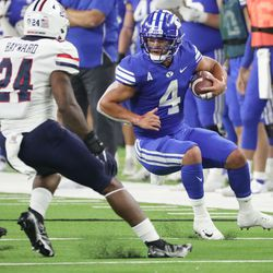 Brigham Young Cougars running back Lopini Katoa (4) rushes during the Vegas Kickoff Classic in Las Vegas on Saturday, Sept. 4, 2021.