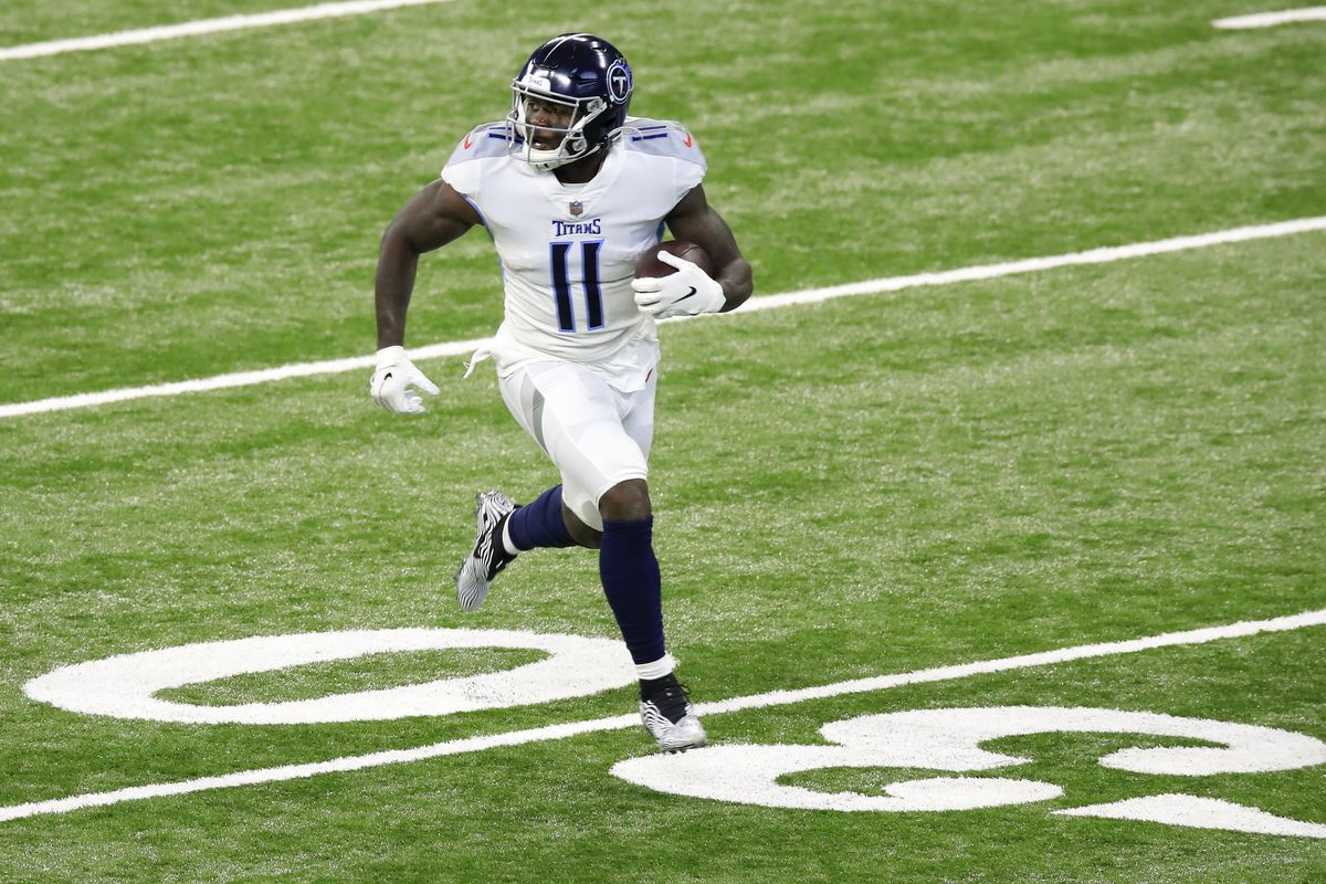 A.J. Brown #11 of the Tennessee Titans carries the ball for a touchdown following a catch in the first quarter during their game against the Indianapolis Colts at Lucas Oil Stadium on November 29, 2020 in Indianapolis, Indiana.