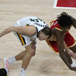 Utah Jazz forward Bojan Bogdanovic (44) and Atlanta Hawks guard Cam Reddish (22) chase the ball during the second half of an NBA basketball game Thursday, Feb. 4, 2021, in Atlanta.
