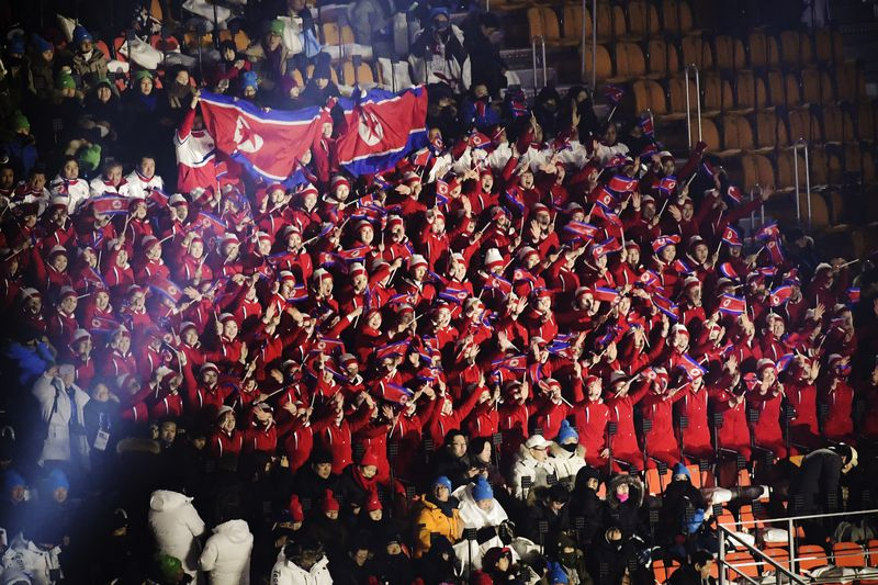 North Korean cheerleaders hold North Korea flags before the opening ceremony of the Pyeongchang 2018 Winter Olympic Games.