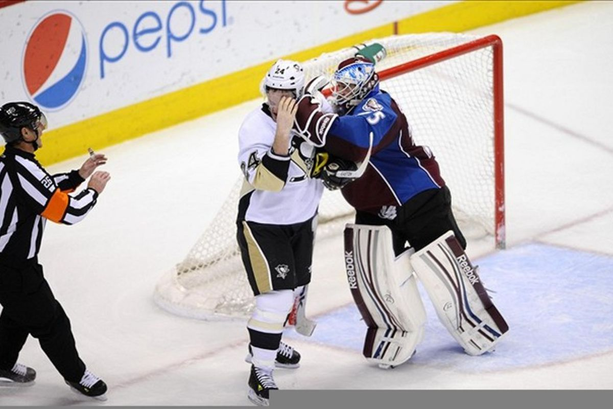 March 3 2012; Denver, CO, USA; Colorado Avalanche goalie Jean-Sebastien Giguere (35) punches Pittsburgh Penguins left wing Matt Cooke (24) in the face during the second period of the game at the Pepsi Center. Mandatory Credit: Ron Chenoy-US PRESSWIRE