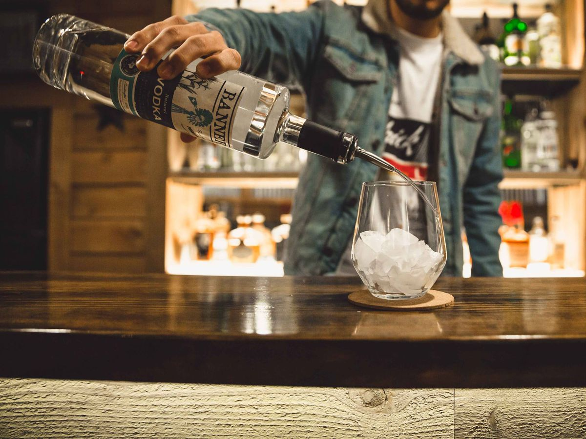 Pouring vodka at Banner Distilling Co.