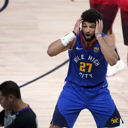 Denver Nuggets' Jamal Murray (27) reacts to a call during the first half of an NBA basketball first round playoff game against the Utah Jazz Sunday, Aug. 23, 2020, in Lake Buena Vista, Fla.