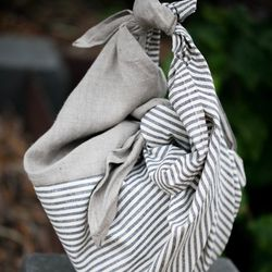 <b>Olives & Grace</b> just started stocking San Francisco-made <b>Ambatalia</b> multi-purpose linen goods. One moment the Furoshiki ($42) carries hostess gifts and picnics; the other it's an apron or grocery bag.