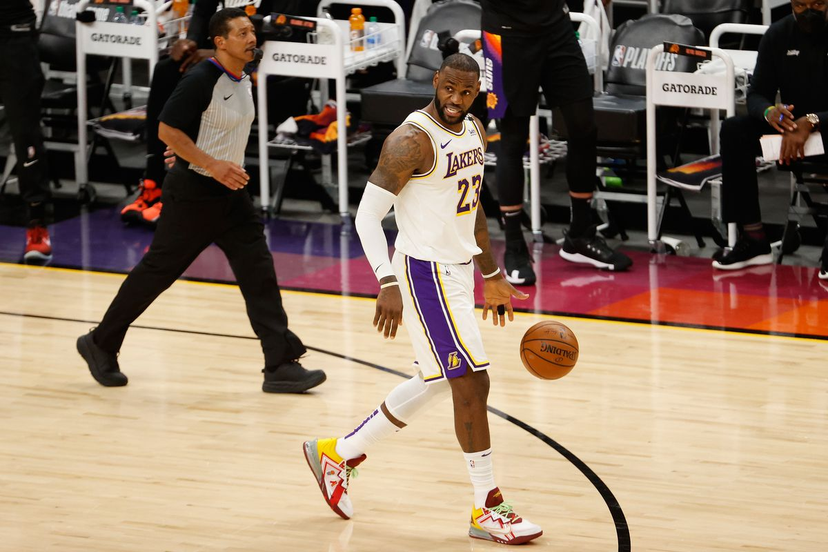 LeBron James of the Los Angeles Lakers handles the ball against the Phoenix Suns during the first half of Game One of the Western Conference first-round playoff series at Phoenix Suns Arena on May 23, 2021 in Phoenix, Arizona.