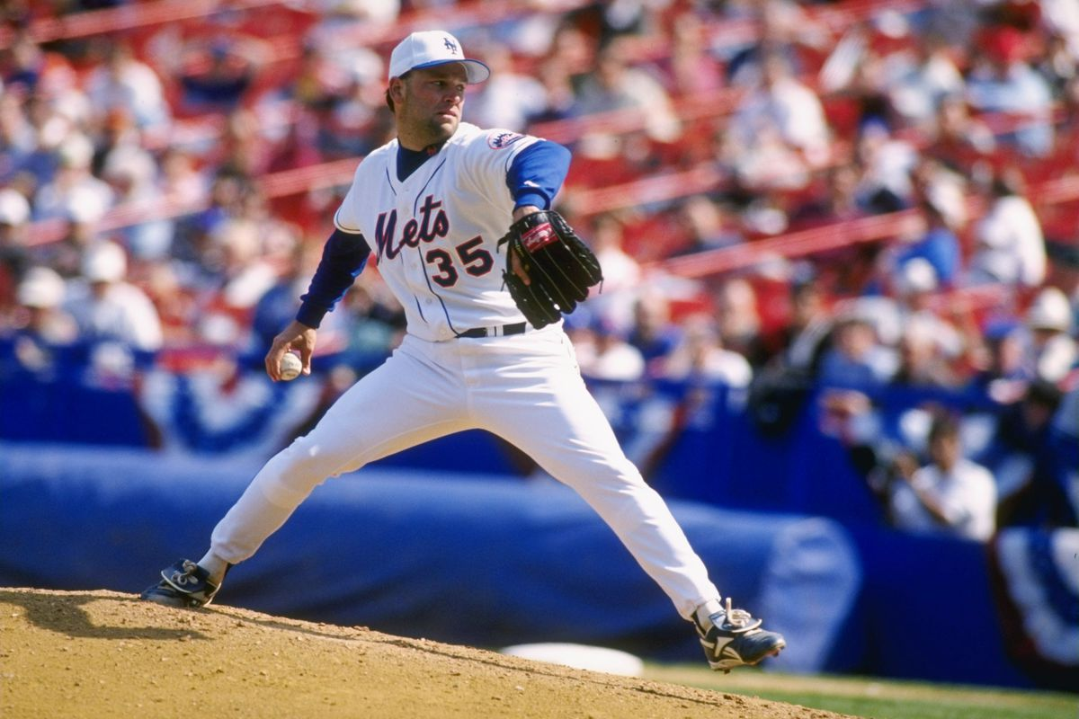 Rick Reed wearing a white Mets hat