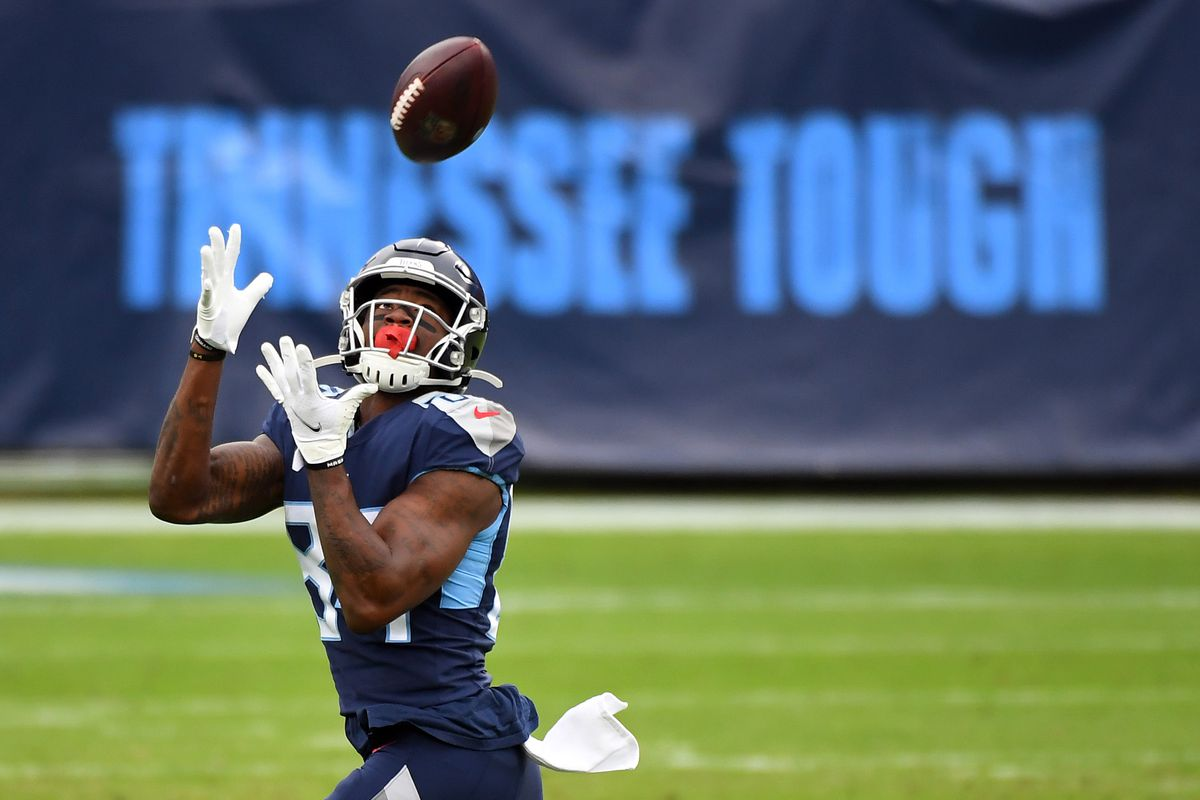 Tennessee Titans wide receiver Corey Davis (84) catches a 75-yard touchdown pass against the Detroit Lions during the first half at Nissan Stadium.