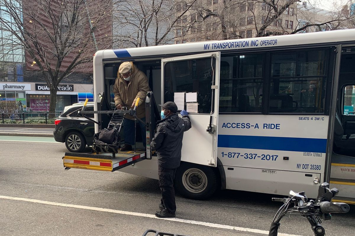 A man is lowered by an Access-A-Ride vehicle in Union Square.