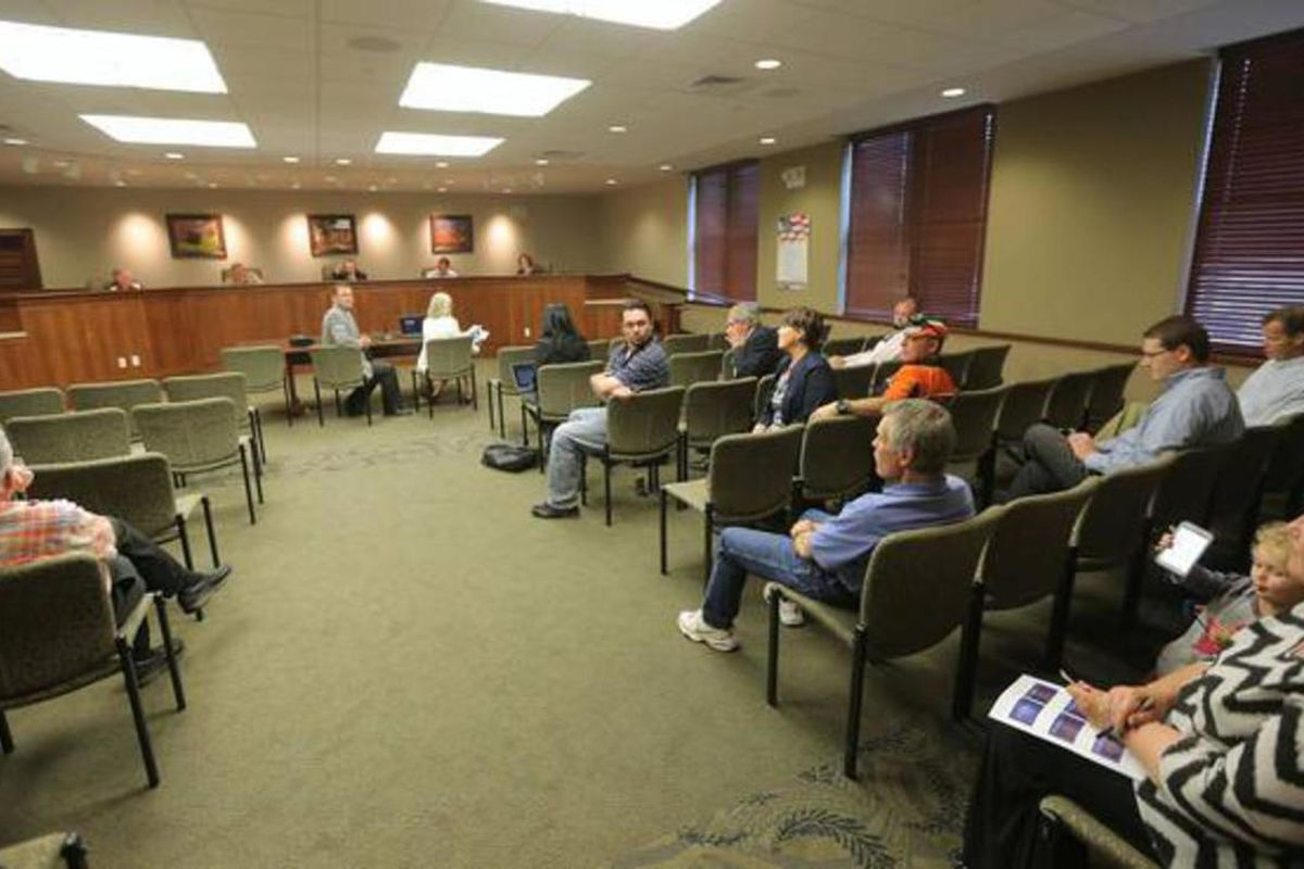A small group of residents and a few state representatives attend a Garfield County Commission meeting Monday, June 8, 2015, in Panguitch discussing county economic troubles and declining school enrollment since 1996.