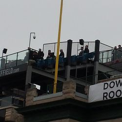 Closeup of Cubs personnel and others on the Skybox on Sheffield rooftop