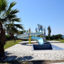 An abandoned water slide bakes in the sun at the Kyllini refugee camp in western Greece, July 11, 2016. The camp was previously a luxury resort before it fell into disrepair and was later revived as a refugee camp.