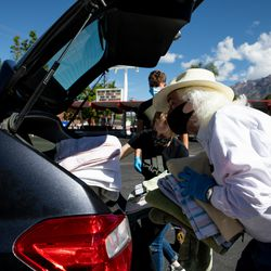"""Alex McDonald, Olivia Erickson and Joshua Petersen collect towels as part of their drive for the Ogden Rescue Mission and the Lantern House outside Kirt's Family Drive Inn in Ogden on Monday, May 25, 2020. """"I've been surprised, many people said 'thanks for giving us the opportunity to help, we just didn't know how,'"""" Grant Protzman said. """"There's a real need."""""""