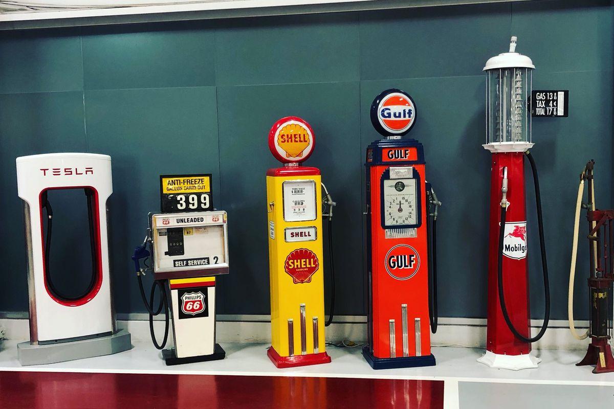 Vintage gas pumps plus a Tesla charger
