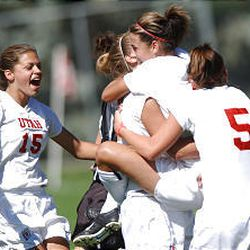 Hailey Marsh (15) celebrates with her teammates Sunday after win.