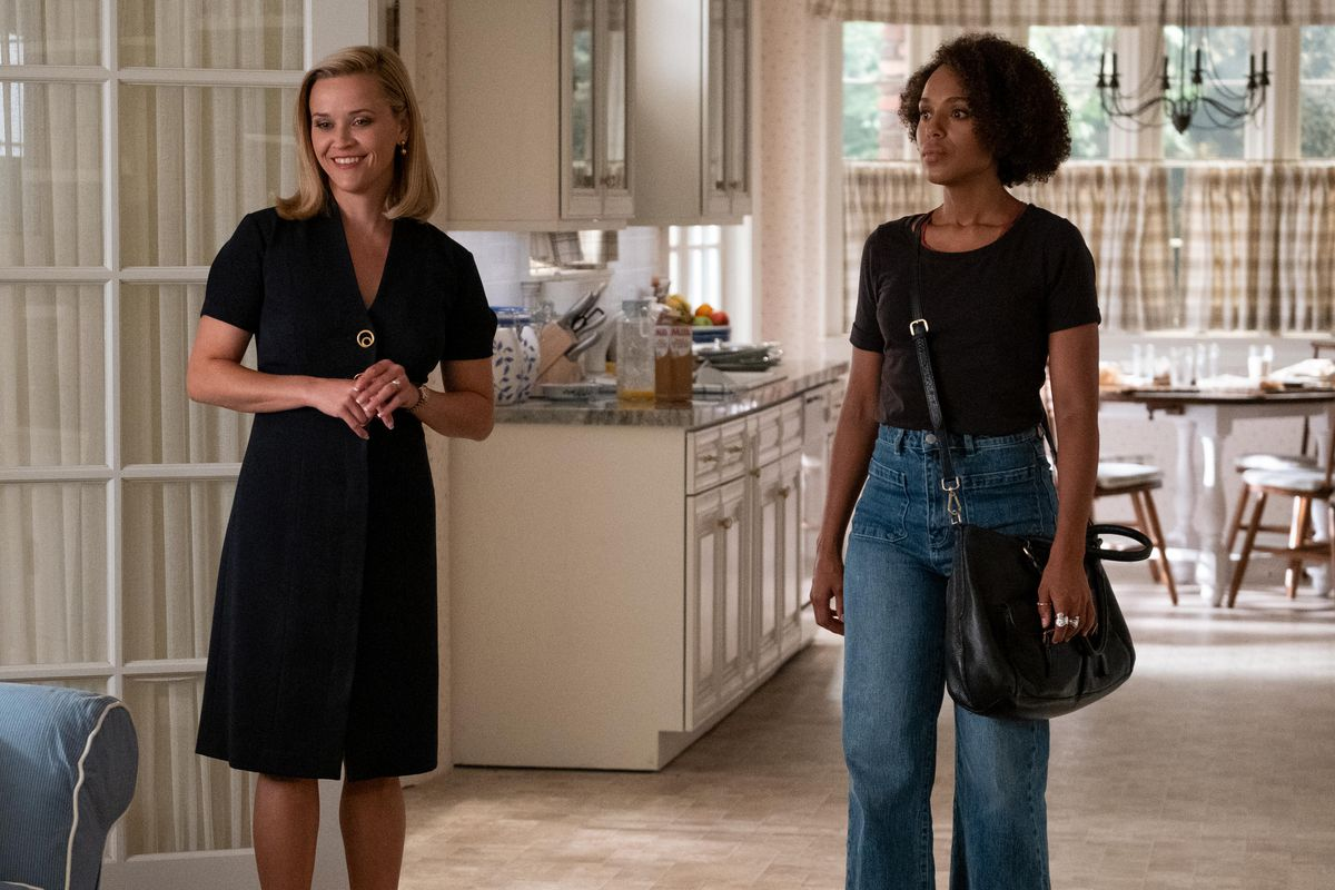 elena richardson and mia warren side-by-side; elena is smiling cheerfully, while mia looks sullen