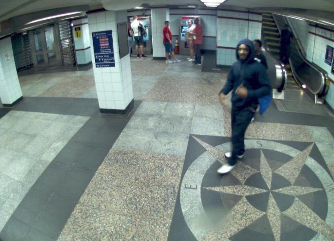 Chicago Police are looking for the man wearing all black in this CTA surveillance image, after a shooting Aug. 17 at the Jackson Red Line platform.   Chicago Police photo