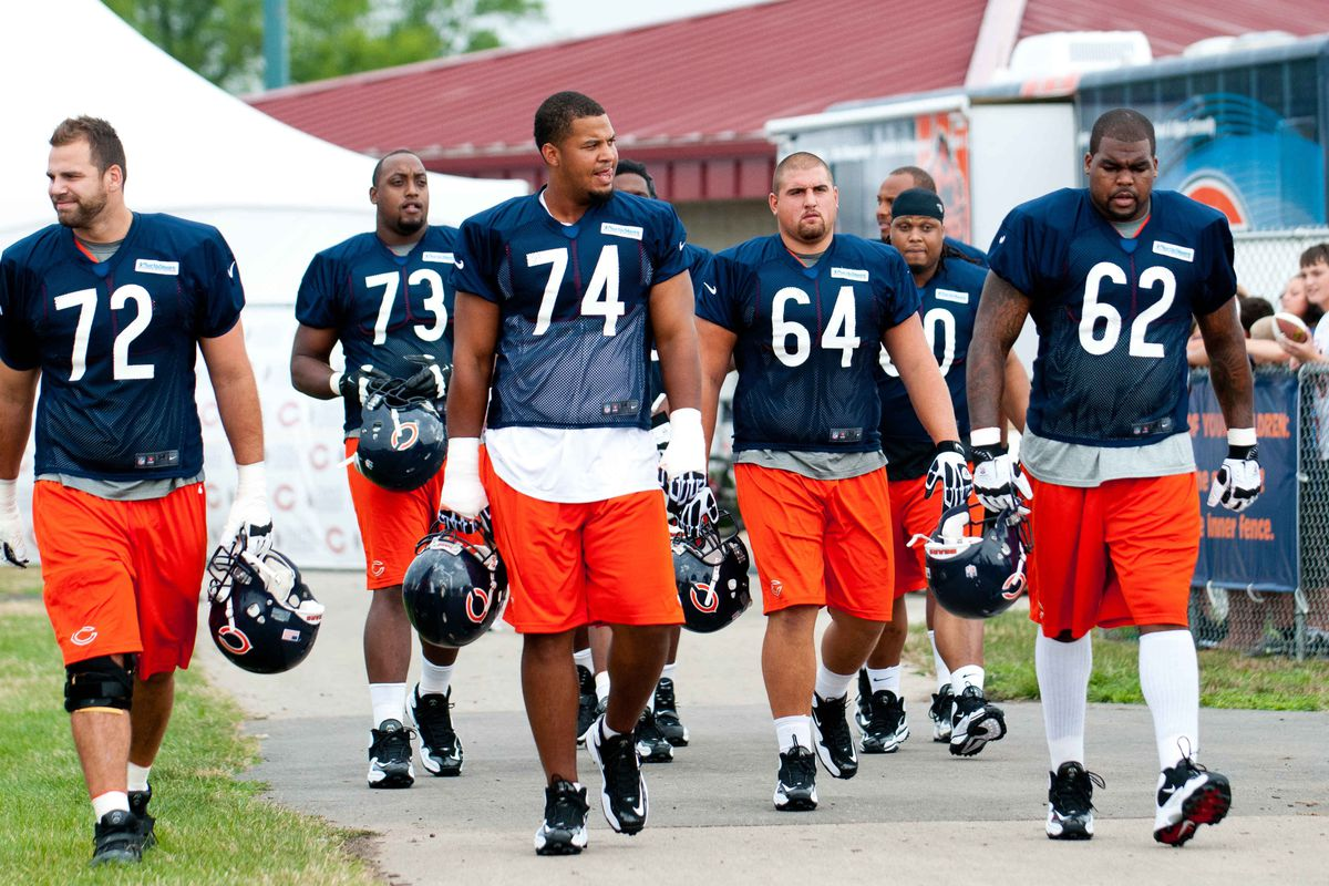 Jul 26, 2012; Bourbonnais, IL, USA; Chicago Bears players walk to the practice field during the opening day of training camp at Olivet Nazarene University. Mandatory Credit: Bradley Leeb-US PRESSWIRE