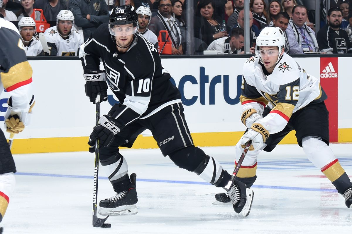 LOS ANGELES, CA - SEPTEMBER 20: Brett Sutter #10 of the Los Angeles Kings skates with the puck while pursued by Erik Brannstrom #12 of the Vegas Golden Knights during the third period of the game at STAPLES Center on September 20, 2018 in Los Angeles, California.