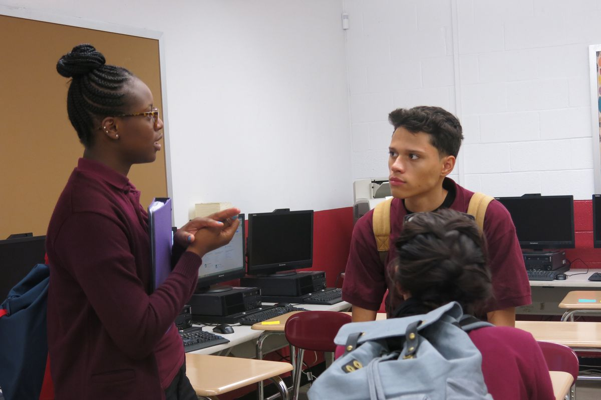 Students stay after class to talk about school segregation.