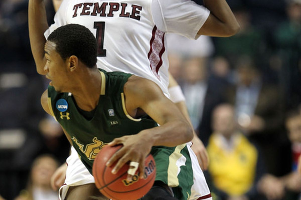 Anthony Collins sliding by Temple's Khaliff Wyatt in the USF's victory over Temple in the 2012 NCAA Tournament