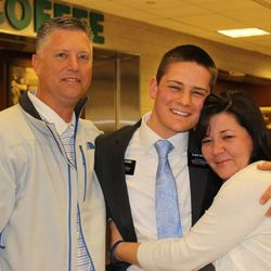 Elder Kyle Rusick, center, gets a big hug from his mother Janice as he greets her and his father Rich after returning home Wednesday, April 1, 2015, from serving as an LDS missionary in the Illinois Chicago West Mission. The mission, and Elder Rusick, were part of a pilot program for using iPads and Facebook as missionary tools. The Rusicks welcomed their son home Wednesday morning, then took a daughter to the Missionary Training Center in Provo that afternoon.