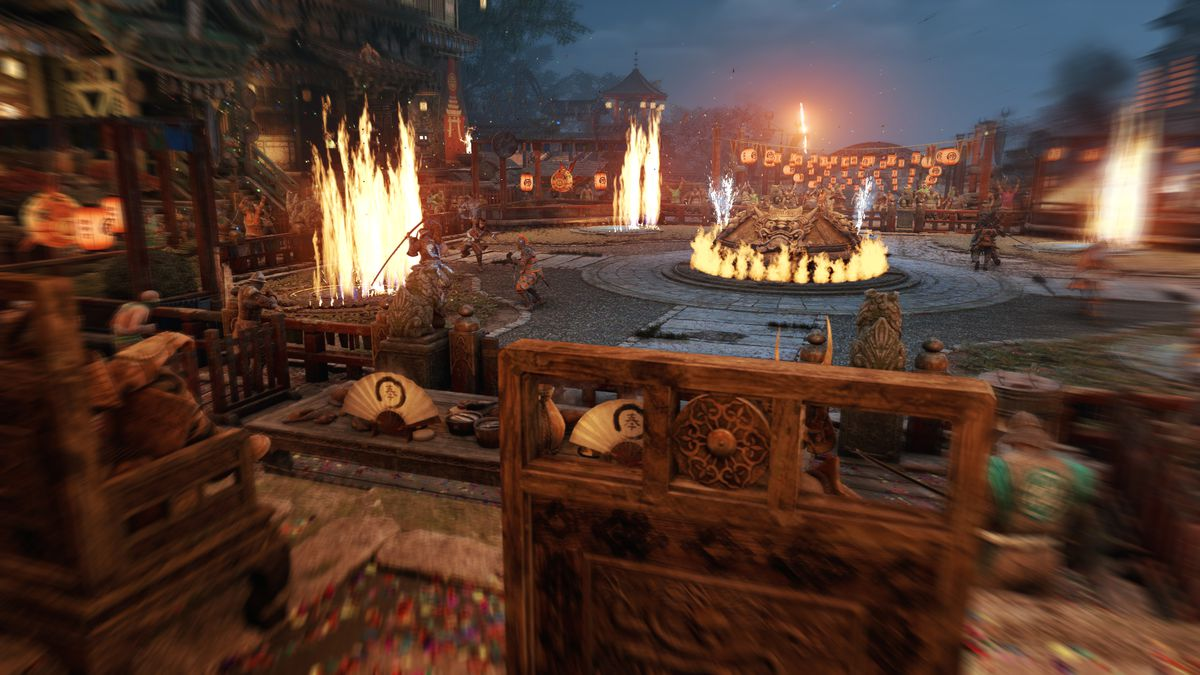wide shot of a combat arena in For Honor showing columns of fire spewing out at the corners
