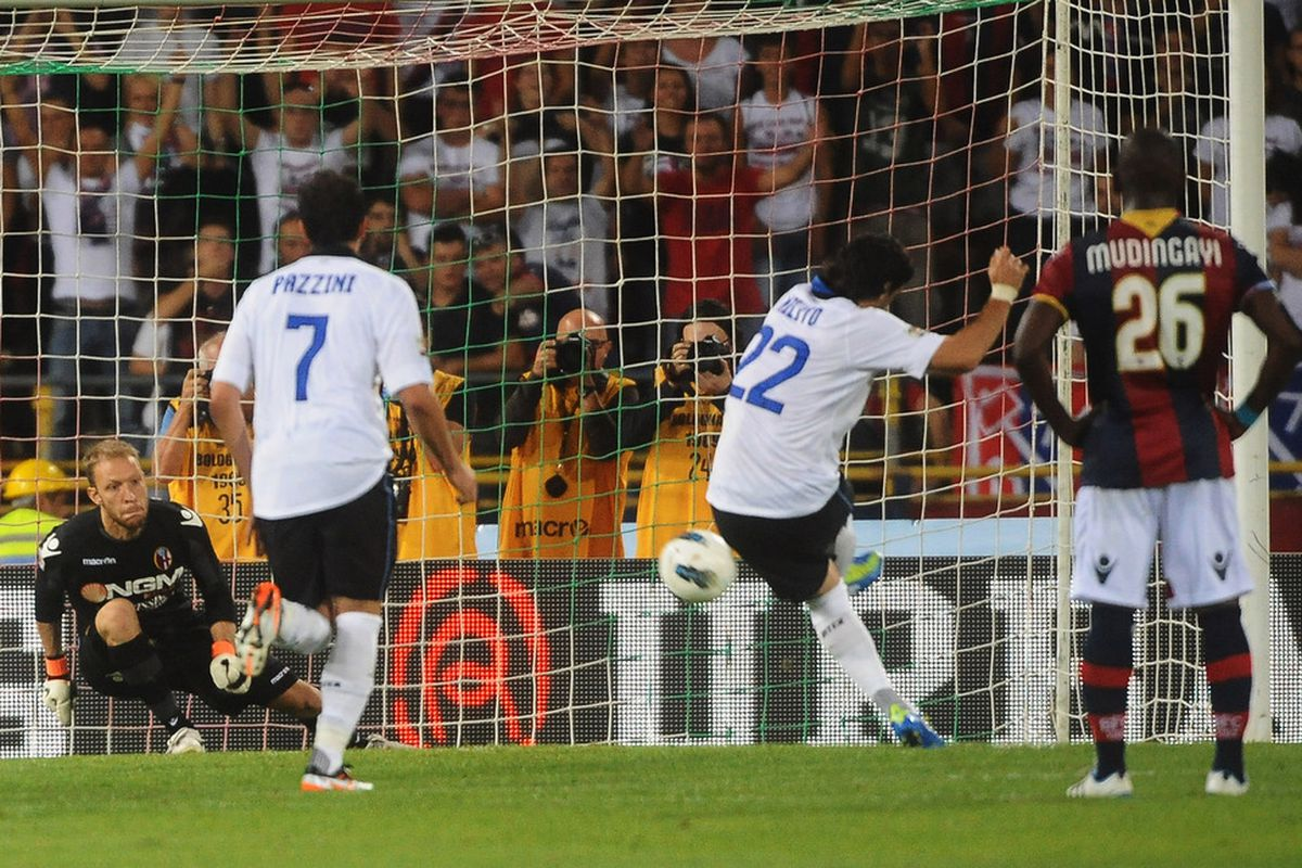 Milito converts a penalty against Bologna last year.