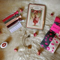 """From <a href=""""http://www.aokiboutique.com/"""">Aoki Boutique</a> (clockwise from top): Vintage Valentines by Cavallini & Co, $15/12 assorted cards; Betsey Johnson Kiss Knee Socks, $15; Love Letter Necklace by Ornamental Things, $56; Kiss Pill Box by Homart,"""